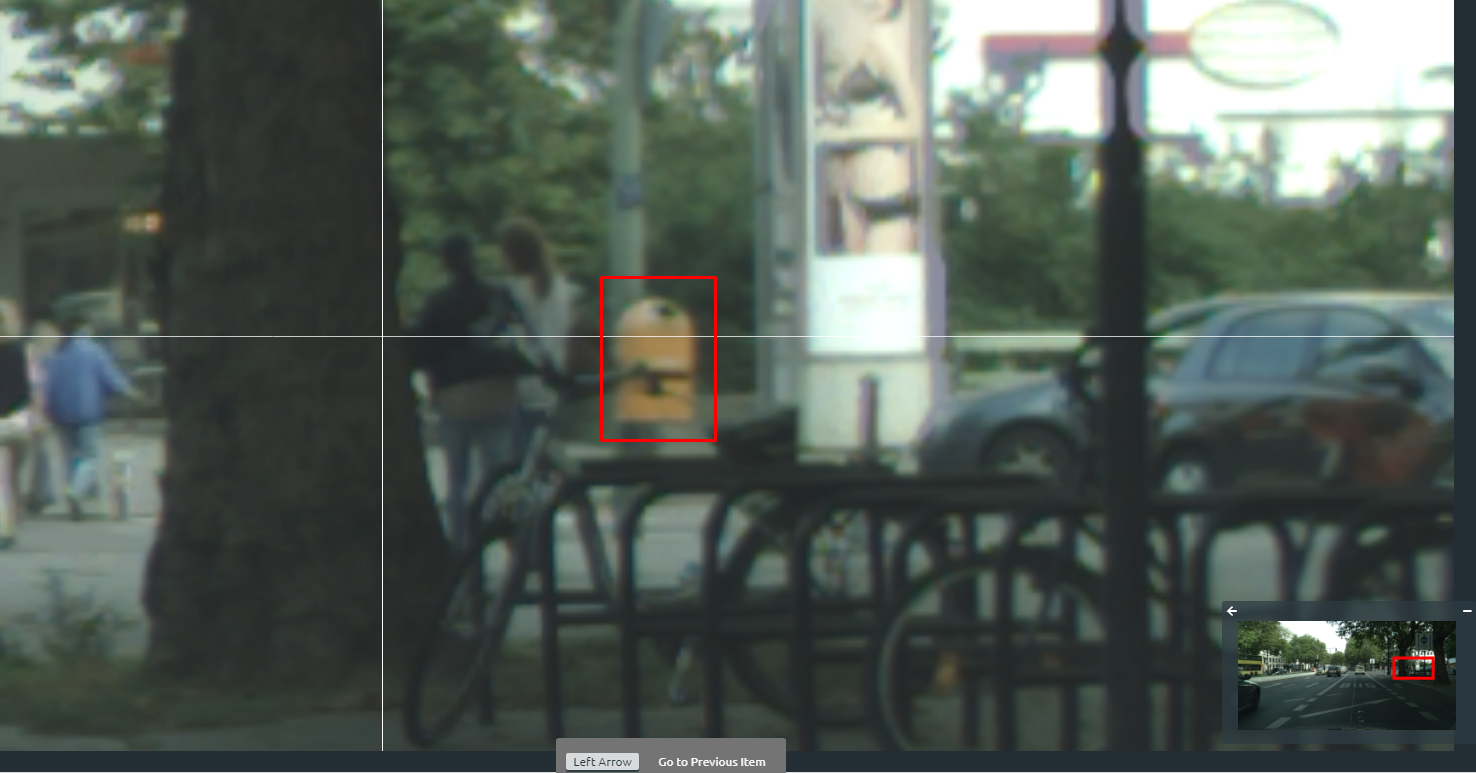 Data annotation tools can include automation, also called auto labeling, which uses artificial intelligence to label data, and workers can confirm or correct those labels, saving time in the process. This screenshot of a street sign shows how auto-labeling enriched an image with a bounding box around a garbage can. It was a mistake. It labeled the object as a person. While auto labeling is not perfect, it can provide a helpful starting point and reduce task time for teams of data labelers.