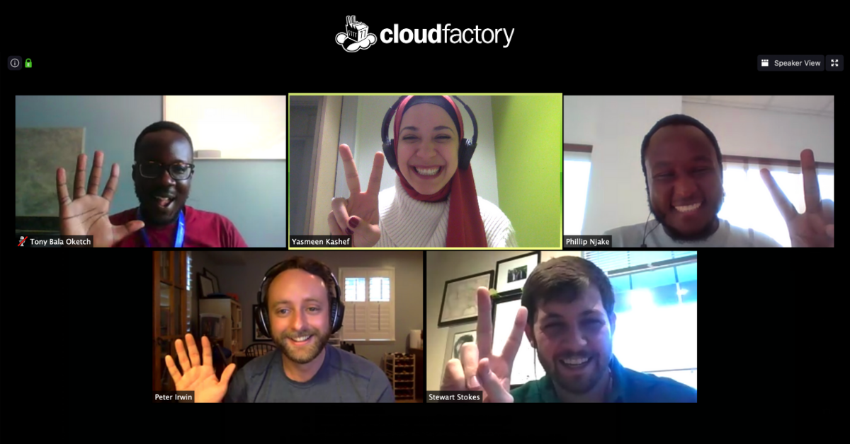 In this screenshot of a Zoom video meeting, five CloudFactory employees are smiling, laughing and making the peace symbol with their hands during the 17th pod social call of 2020.